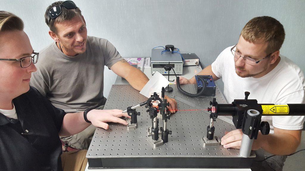 Baker College students perform experiment in photonics lab, Flint, MI