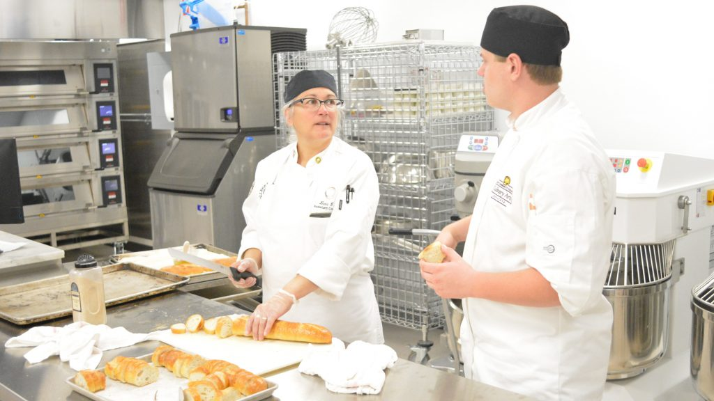 Students learn culinary techniques at Mott Community College Culinary Institute