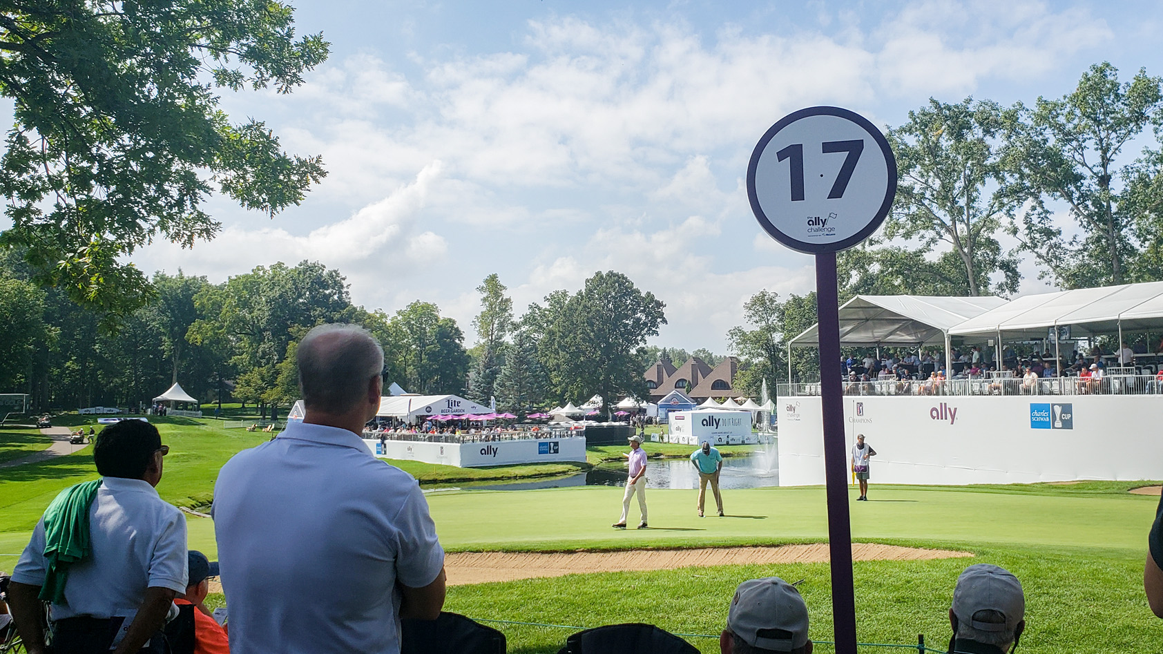 Fans watch golfers from 17th hole at Ally Challenge in Grand Blanc, MI