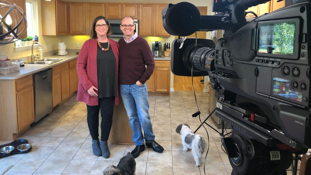 Matt Bach and wife appear in their kitchen in front of HGTV House Hunter camera