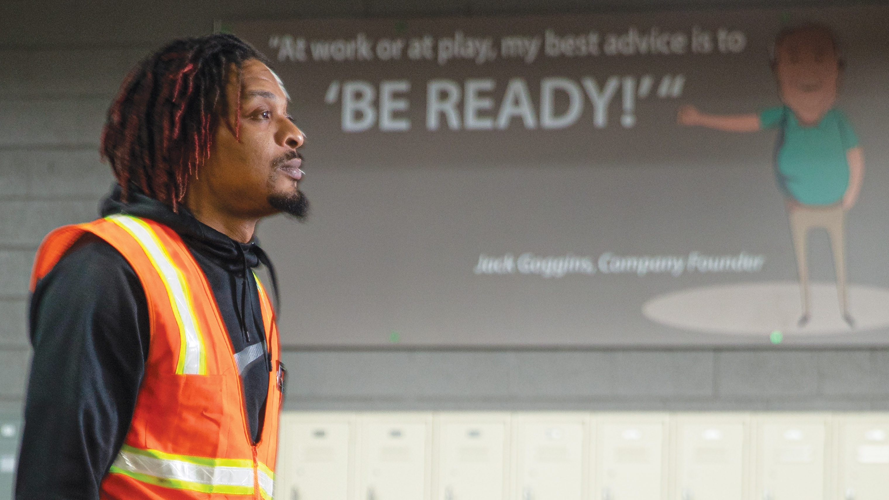 NorthGate employee walks by 'Be Ready' program sign